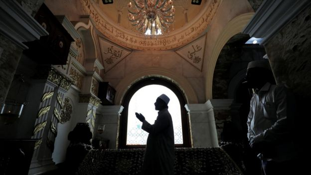 A Muslim priest prays during Eid al-Fitr to mark the end of the holy fasting month of Ramadan at Dewatagaha Mosque in Colombo, Sri Lanka on 24 May 2020