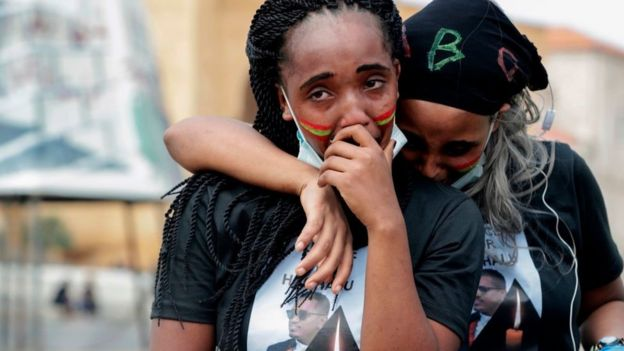 Members of the Oromo Ethiopian community in Lebanon mourn as they take part in a demonstration to protest the death of musician and activist Hachalu Hundessa, in the capital Beirut on July 5, 2020