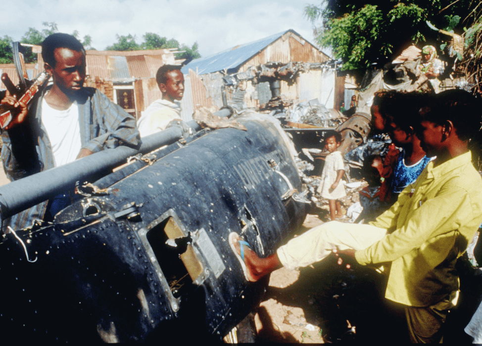 Children play with the wreckage of a US Black Hawk helicopter in Mogadishu, Somalia in December 1993