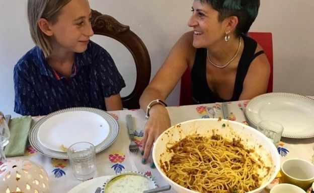 "Italians at a table where ""suugo suqaar""and ""baasto"" is being served in Palermo, Sicily - Italy, 2019"
