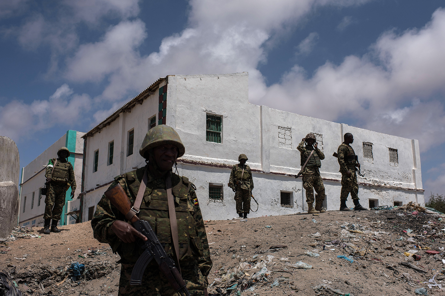 Ugandan soldiers deployed with the African Union Mission in Somalia (AMISOM) look at the beach in Barawe, Somalia, on Oct. 11, 2016.