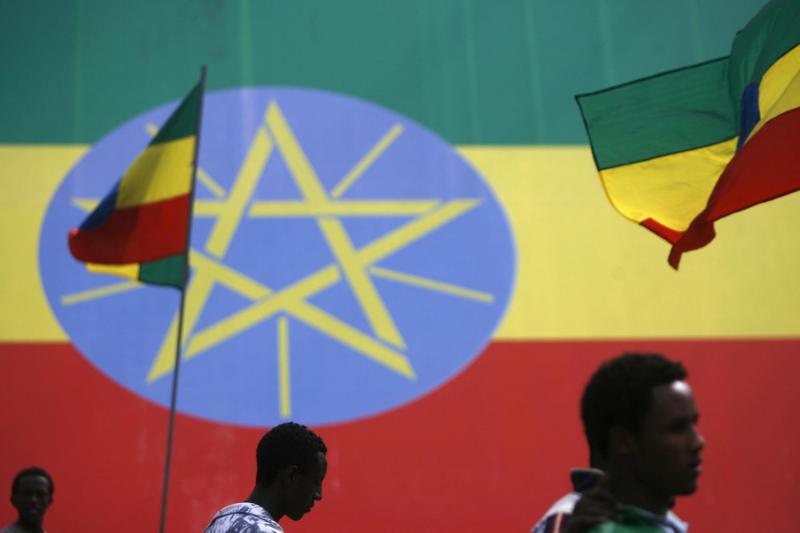 People walk in front of Ethiopian flags marking the new Ethiopian Millennium on Sept. 10, 2007 in Addis Ababa, Ethiopia.