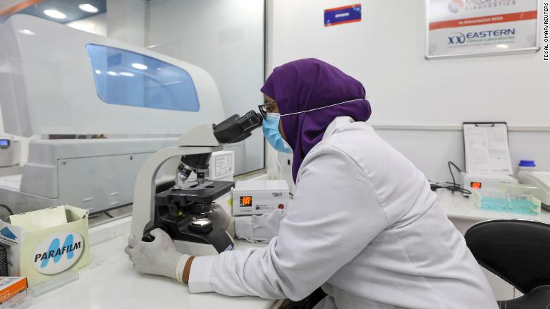 Aisha Abdi Mohamed, a laboratory technician, uses a microscope inside the Medipark Diagnostics lab that runs tests for the coronavirus disease (COVID-19), in Mogadishu, Somalia October 14, 2020.