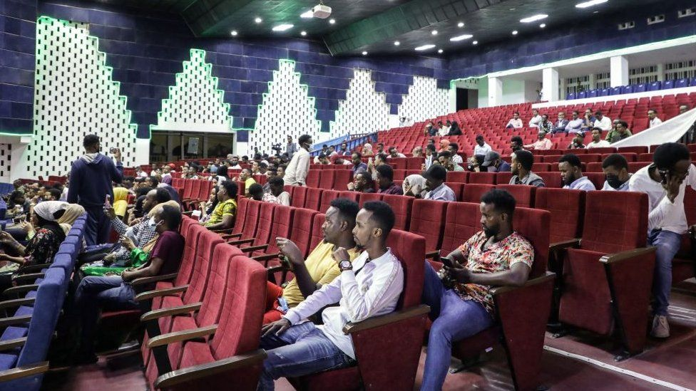 Viewers wait for the film screening at the Somali National Theatre in Mogadishu on 22 September 2021